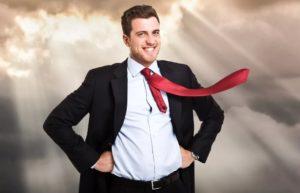 Успешный мужчина с красным галстуком